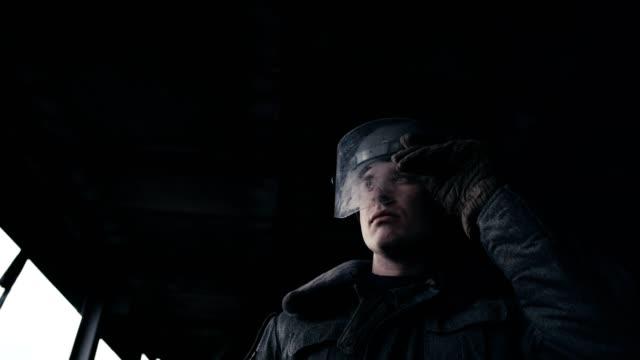 abandoned warehouse. polish martial law 1981. socialist militiaman on patrol - poland stock videos and b-roll footage