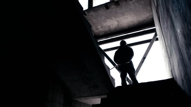 abandoned warehouse. polish martial law 1981. socialist militiaman on patrol - poland stock videos & royalty-free footage