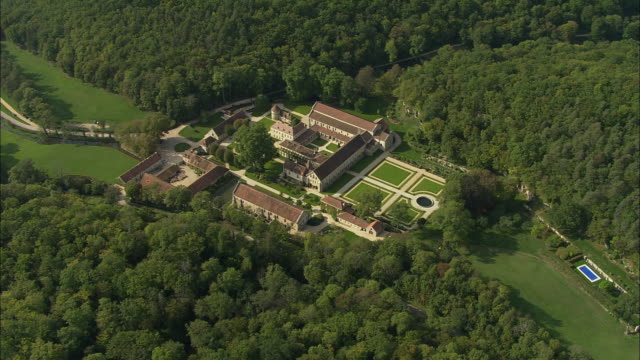 aerial ws abbey of fontenay and surrounding landscape / montbard, burgundy, france - monastery stock videos & royalty-free footage