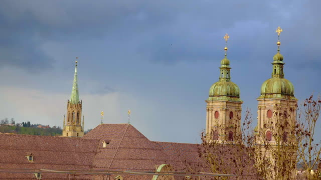 abbey of st gallen with storm cloud and wind with sunlight - kathedrale stock-videos und b-roll-filmmaterial