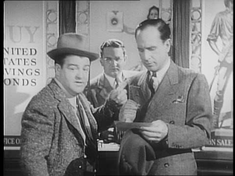 abbott and costello stand in line to purchase war bonds war bond posters in background cross dialogue with gags / man talks to them / abbott and... - financial accessory stock videos & royalty-free footage