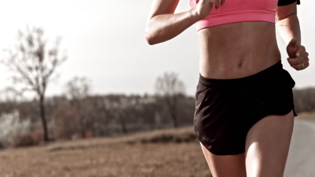 slo mo ts abdomen of a female runner - running shorts stock videos and b-roll footage