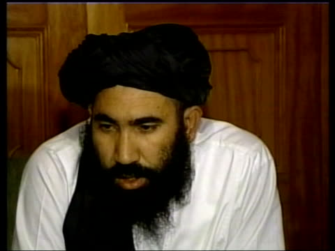 vídeos de stock e filmes b-roll de abdul salam zaeef press conference sot agreed to surrender kandahar and other places peacefully - kandahar