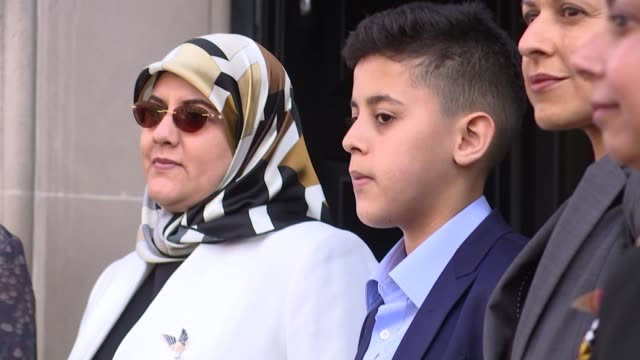 wife arrives at parliament england london westminster ext fatima boudchar and family members arrive at 1 parliament street / brief photocall on... - fototermin stock-videos und b-roll-filmmaterial