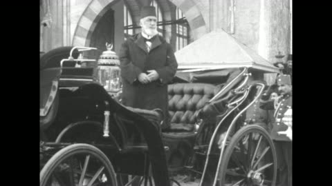 abdulmejid ii, the last caliph of turkey, gets into carriage waves hand in muslim gesture and salutes then sits, carriage rolls forward accompanied... - image stock-videos und b-roll-filmmaterial