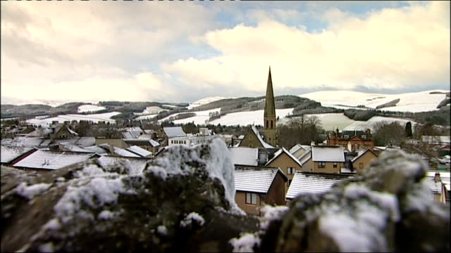 stockvideo's en b-roll-footage met aberdeen wide shot of snowcovered mountain and bare tree wide shot of residential area with snowcovered rooftops wide shot of houses with snowcovered... - bare tree