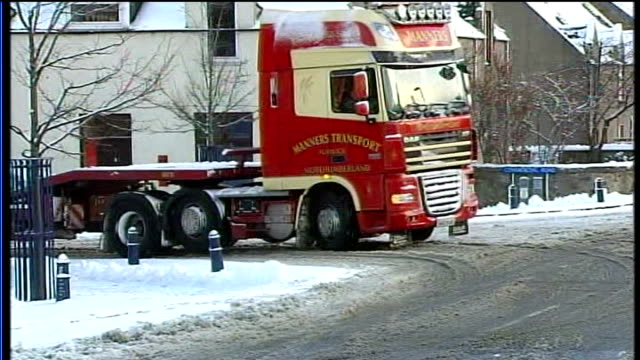 aberdeenshire freight lorry stuck on snowy road truck's wheels slipping in sludge - aberdeenshire stock videos & royalty-free footage