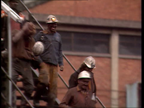 aberfan community fights pit closure wales merthyr vale av pit wheel rotating as music of miners' song sof ms miners walking down steps ms pithead as... - 発電所関係の職業点の映像素材/bロール