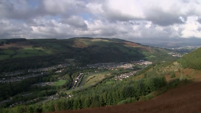 stockvideo's en b-roll-footage met village prepares to mark 50th anniversary mountain looming over aberfan from where the colliery spill tip cascaded down through the village killing... - 50 jarig jubileum