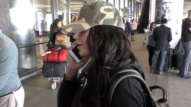 INTERVIEW Abigail Ratchford talks about her photo shoot with American Flag while arriving at LAX Airport in Los Angeles in Celebrity Sightings in Los...