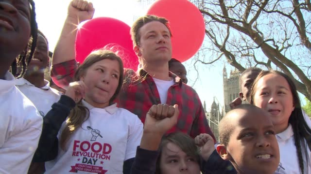 aboard an open top london bus circling britains parliament celebrity chef jamie oliver is educating children about healthy eating and revealing plans... - jamie oliver stock videos & royalty-free footage