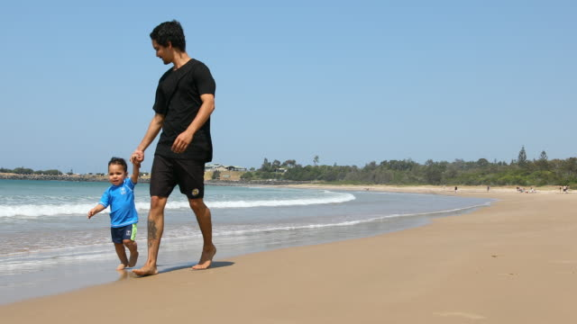 aboriginal australian father and son at the beach - australian aboriginal culture stock videos and b-roll footage