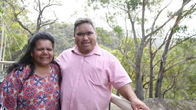 aboriginal couple in their 50s smiling towards camera - aboriginal australian ethnicity stock videos & royalty-free footage