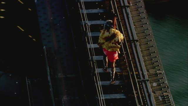 WS PAN TS AERIAL Aboriginal man walking up Sydney Harbor Bridge, Sydney, New South Wales, Australia
