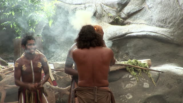 ms zo aboriginal performers dancing, holding smoking hay, queensland, australia - hay stock videos & royalty-free footage