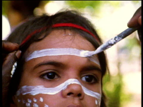 aborigine child has face painted for traditional ceremony australia - australian aboriginal culture stock videos and b-roll footage