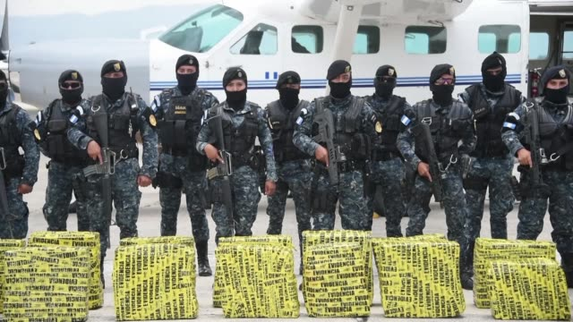 about 2.3 tons of cocaine seized in various police raids in southwestern guatemala arrive at the air force base in the country's capital - law stock videos & royalty-free footage