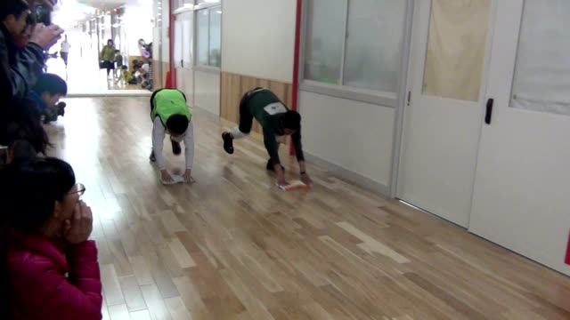 about 270 contestants competed in a rare floor wiping race in japan on february 21. the floor wiping is a traditional educational menu for japanese... - wipe video transition stock videos & royalty-free footage