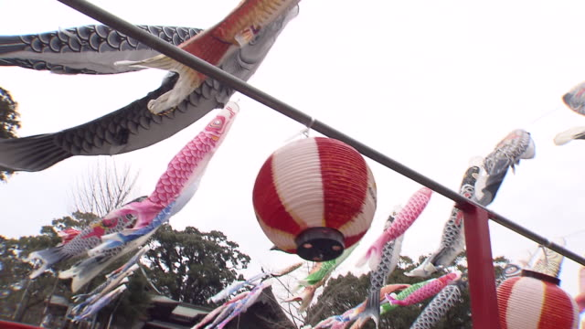about 300 colorful carp streamers are waving in the spring wind at the kanjin bridge that runs across the kase river, saga. you can have fun riding... - streamer stock videos & royalty-free footage