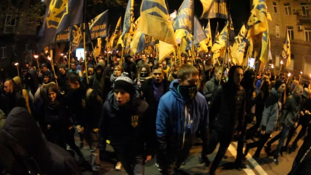 about 5 thousands soldiers of azov and right sector battalions volunteers of the azov civil corps and activists march through the downtown kyiv with... - battalion stock videos & royalty-free footage
