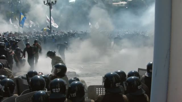 About 50 security officers were wounded in clashes outside Ukrainian parliament on Monday as lawmakers gave initial approval to constitutional...