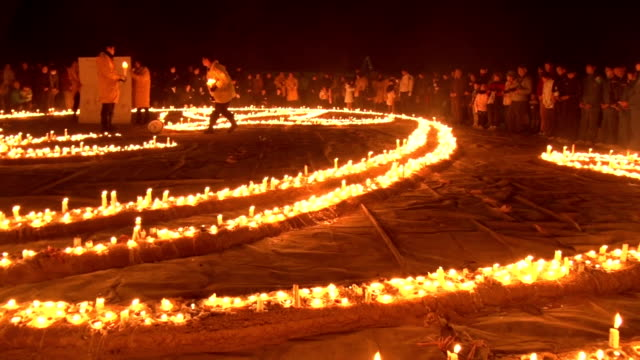 about 6000 candles were lit to remember the victims killed by the 1995 earthquake that hit japan's kobe city and the area around it in itami city... - 16 17 years stock videos & royalty-free footage