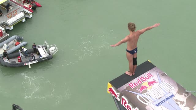 about 70000 people watched the worlds bravest divers plunge off a 27 metre platform on saturday as the first round of the red bull world cliff diving... - diving platform stock videos & royalty-free footage