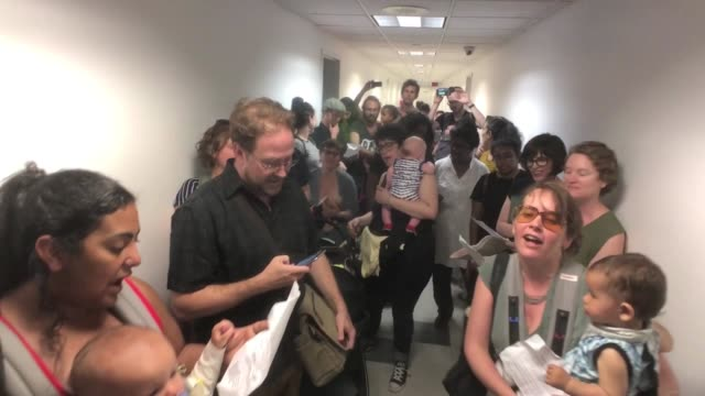 about 80 mothers and their small children storm into the federal building's ice homeland security office on 9th floor of 26 federal plaza unannounced... - small office stock videos & royalty-free footage