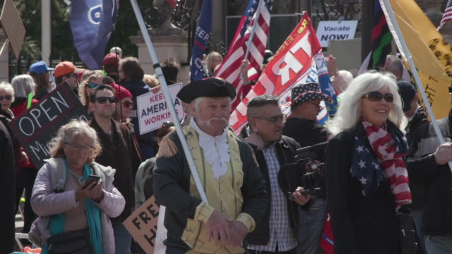 about 800 protesters gathered at the gates of the governor's residence to end stay-at-home orders. - stars and stripes stock videos & royalty-free footage