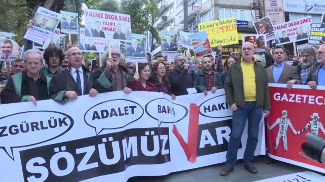 About a hundred people gather in Istanbul's Kadikoy neighbourhood to voice their support for the academics and lawyers who signed the petition...
