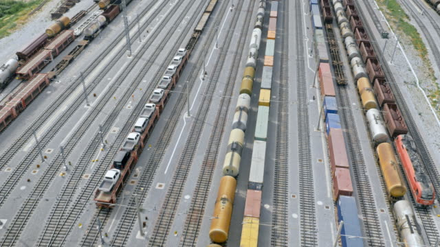 aerial above a cargo train terminal - cargo train stock videos & royalty-free footage