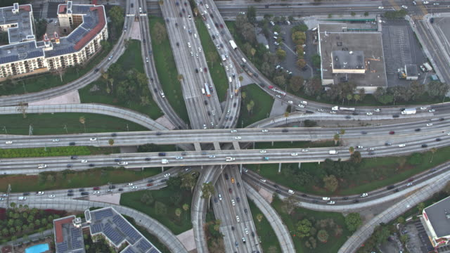 aerial above a complex highway intersection in california - main road stock videos & royalty-free footage