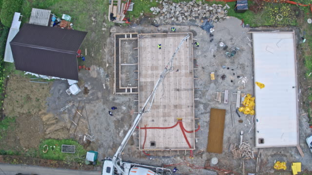 aerial above a construction site - cement mixer stock videos & royalty-free footage
