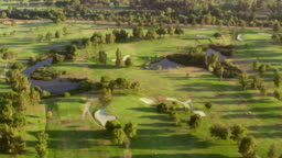 AERIAL Above a golf course in San Fernando Valley in sunshine