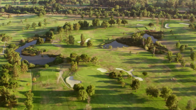 aerial above a golf course in san fernando valley in sunshine - golf course stock videos & royalty-free footage