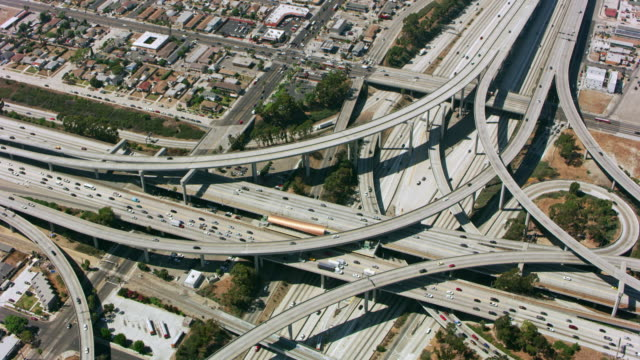aerial above a highway intersection in california, usa - two lane highway stock videos & royalty-free footage