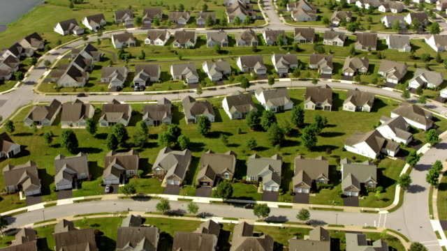 aerial above a tract housing development - tract housing stock videos & royalty-free footage