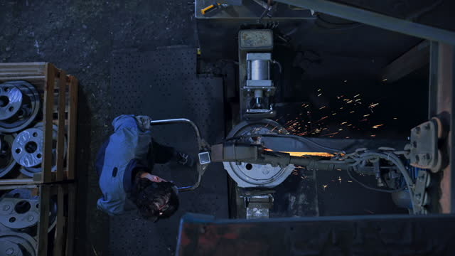 cs above a worker linishing a metal casting - crane shot stock videos & royalty-free footage