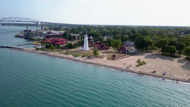 above aerial view of the lighthouse at fort gratiot in port huron, lake huron - michigan video stock e b–roll
