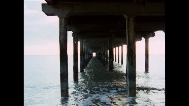 montage above and below a pier on england's coast / united kingdom - peter greenaway stock videos & royalty-free footage