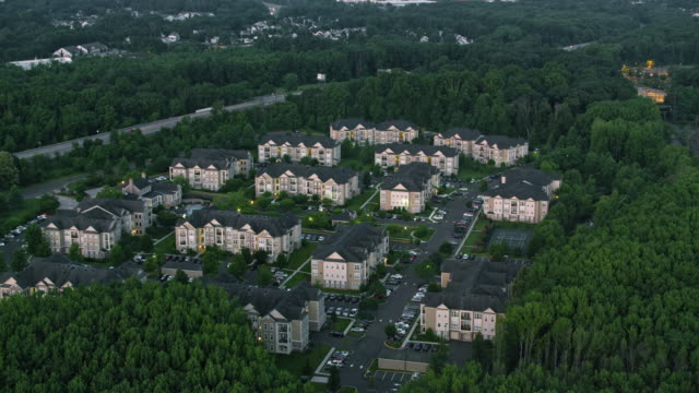 AERIAL Above apartment houses in the suburbs
