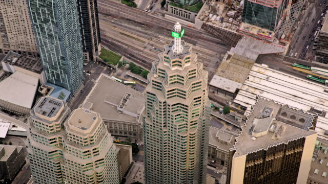 aerial above bay wellington tower in downtown toronto district, ontario - toronto stock videos & royalty-free footage