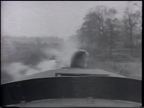 stockvideo's en b-roll-footage met steam train locomotive whistle w/ white steam escaping sot blowing twice td ms railroad tracks ha ws approaching entering railway truss bridge over... - locomotief