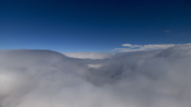 Above clouds, midway right bank