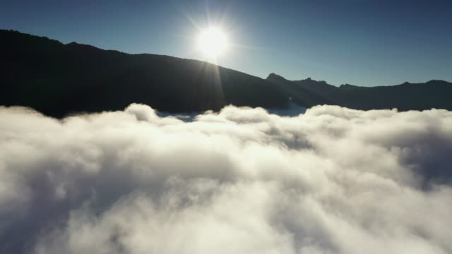 above clouds zoom out a sea of cloud, aerial view nature mountain and clouds and sky in sunrise time, drone shoot - light natural phenomenon stock videos & royalty-free footage
