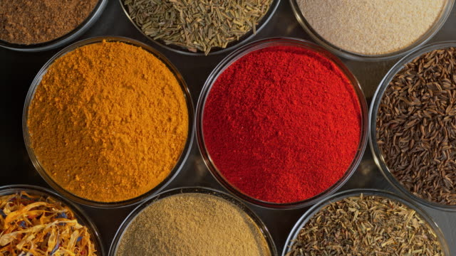 ds above colorful spices in glass bowls - spice stock videos & royalty-free footage