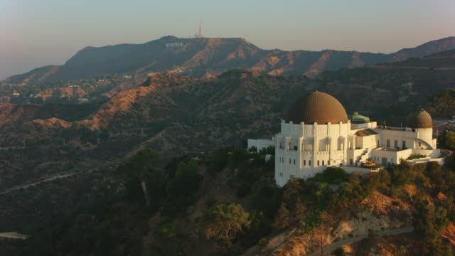 AERIAL Above Griffith Observatory towards the Hollywood sign on the slope of Mt. Hollywood