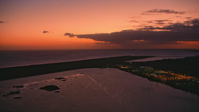 aerial above keehi lagoon in honolulu at night - oahu stock videos & royalty-free footage