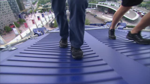 arena rooftop cleaners; england: london: greenwich: ext abseilers cleaning rooftop of o2 arena 'the o2' entrance workers cleaning tent rooftop with... - the o2 england stock videos & royalty-free footage
