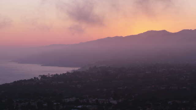 aerial above santa monica at dusk - dusk stock videos & royalty-free footage